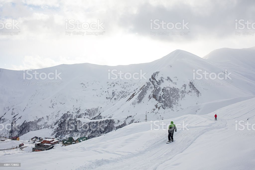 Snowboarder has fun in high winter mountains in Gudauri, Georgia stock photo