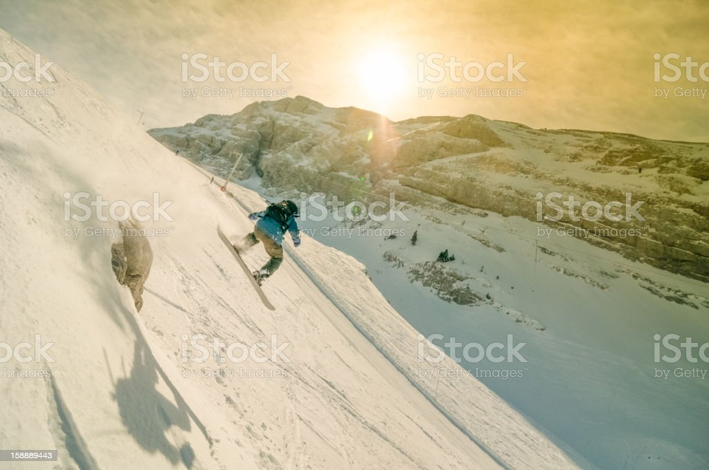 Snowboarder in Acrobatic Jump stock photo