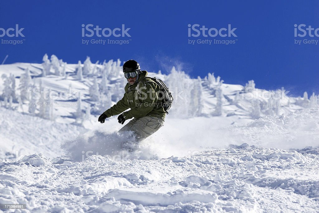 Snowboarder in action in Powder Snow stock photo
