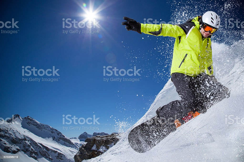 Snowboarder in high mountains stock photo