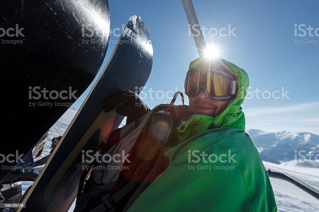 Snowboarder in lift in winter mountains in Gudauri, Georgia stock photo