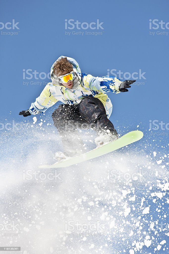 Snowboarder In Mid-Air Making Extreme Jump royalty-free stock photo