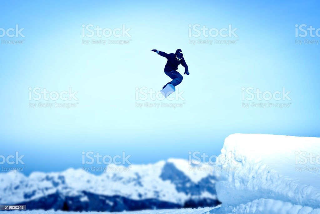 Snowboarder in mid-air stock photo