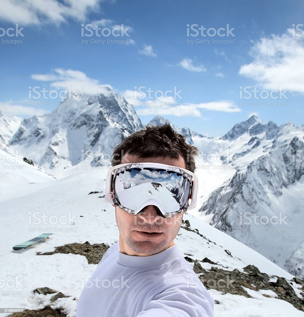 Snowboarder in mountains of the Caucasus stock photo