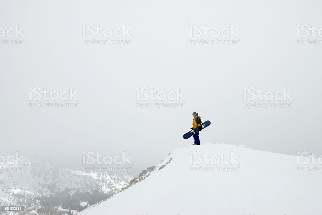 Snowboarder in storm stock photo