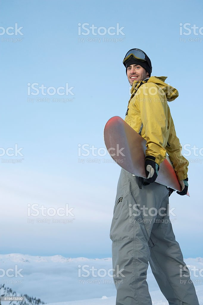 Snowboarder in the mountains stock photo