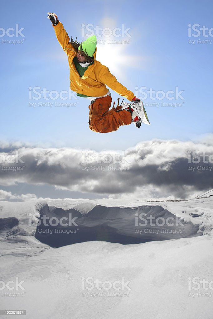 Snowboarder jumping against blue sky royalty-free stock photo