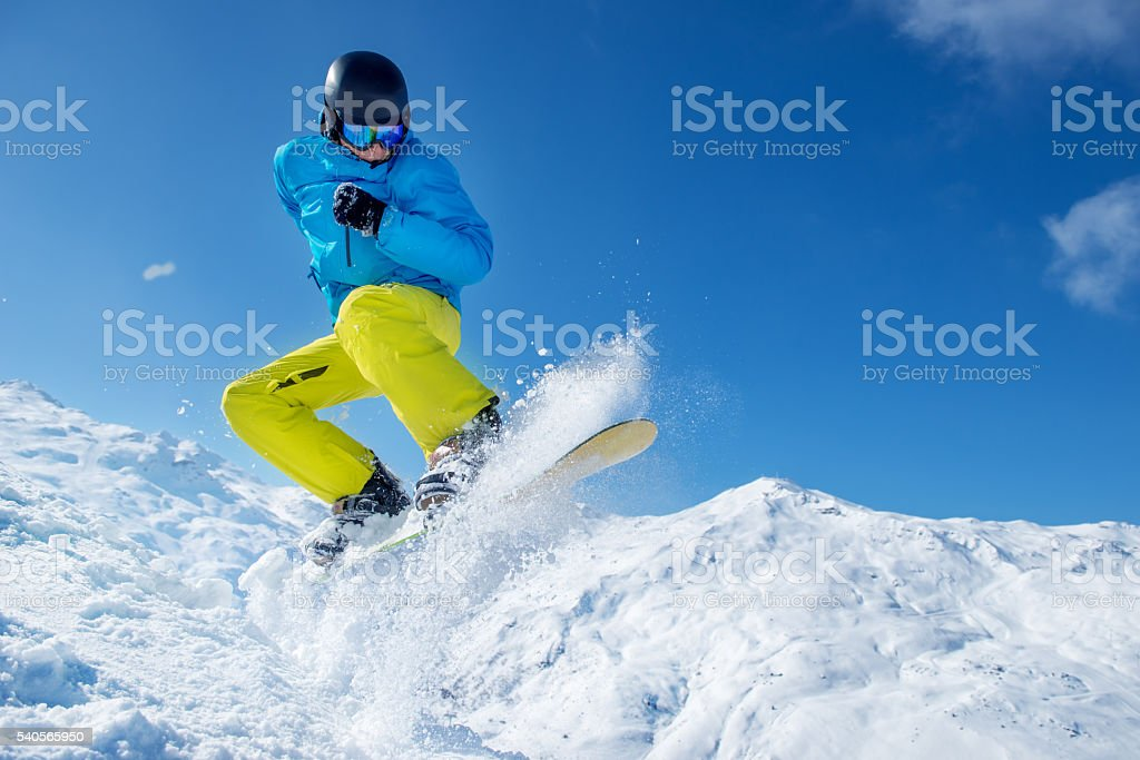 Snowboarder jumping high in the air stock photo