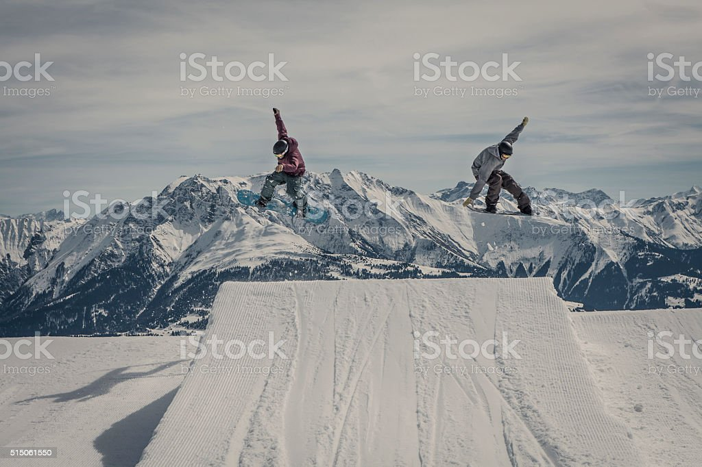snowboarder jumping synchronous stock photo