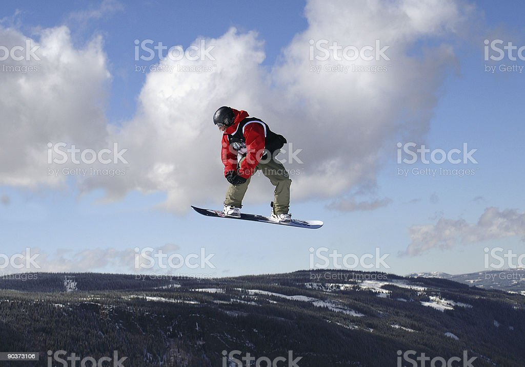 Snowboarder mid-air jump stock photo