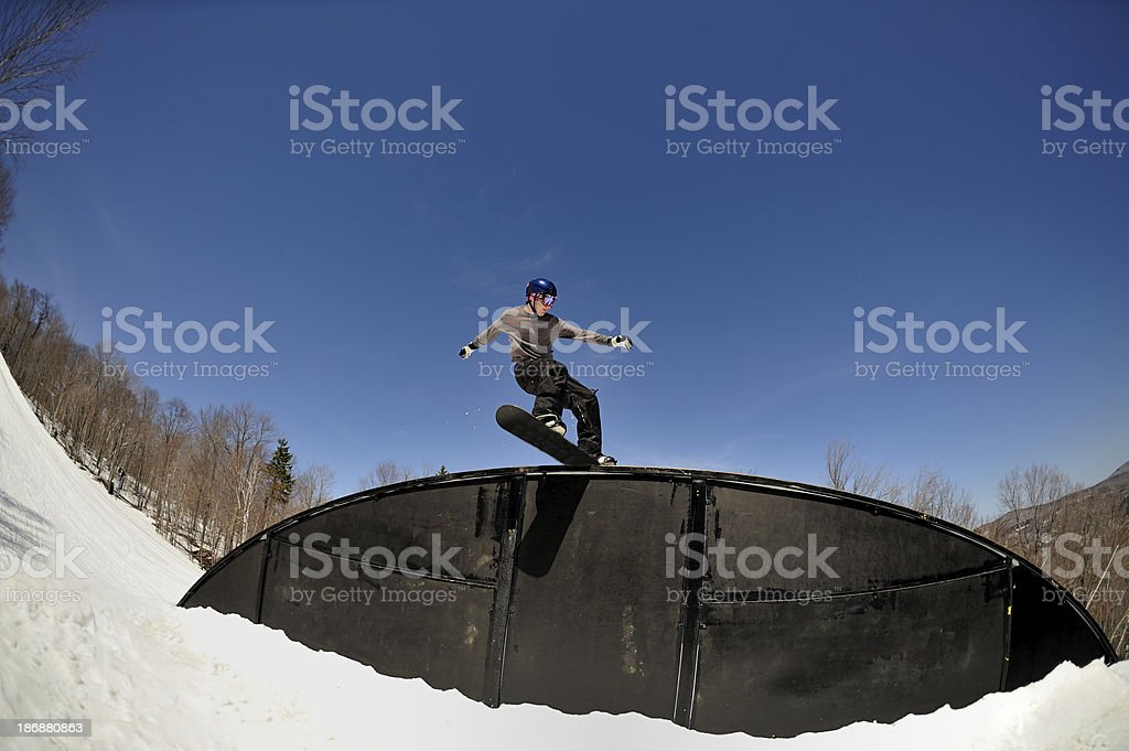 Snowboarder on a rail in  freestyle terrain  park. stock photo