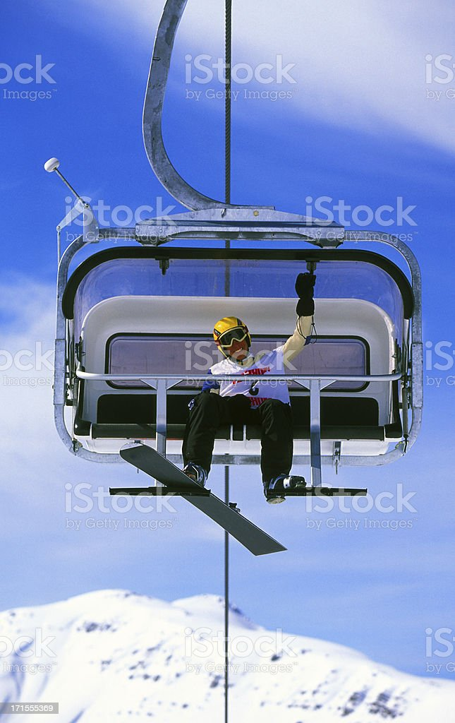 snowboarder on chairlift stock photo