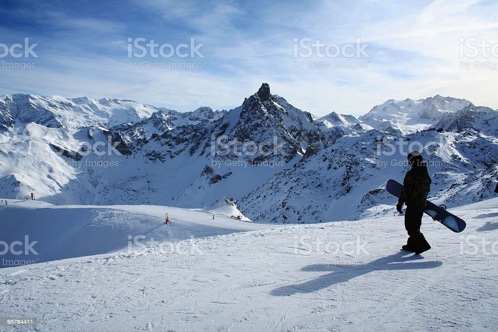 Snowboarder on mountain in Courchevel, France stock photo