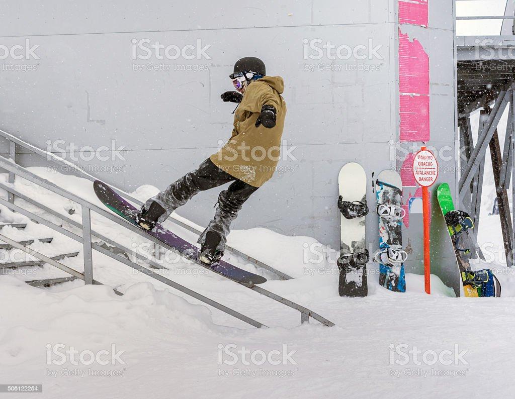 Snowboarder on railing stock photo