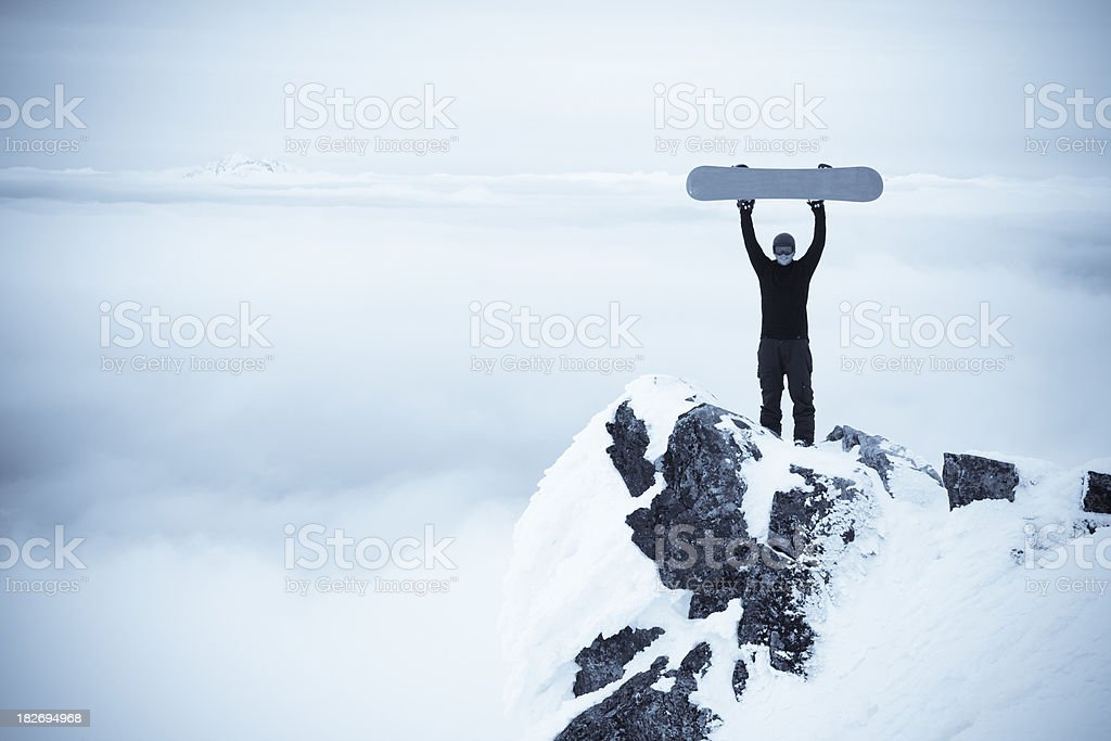 snowboarder on top of cliff. royalty-free stock photo