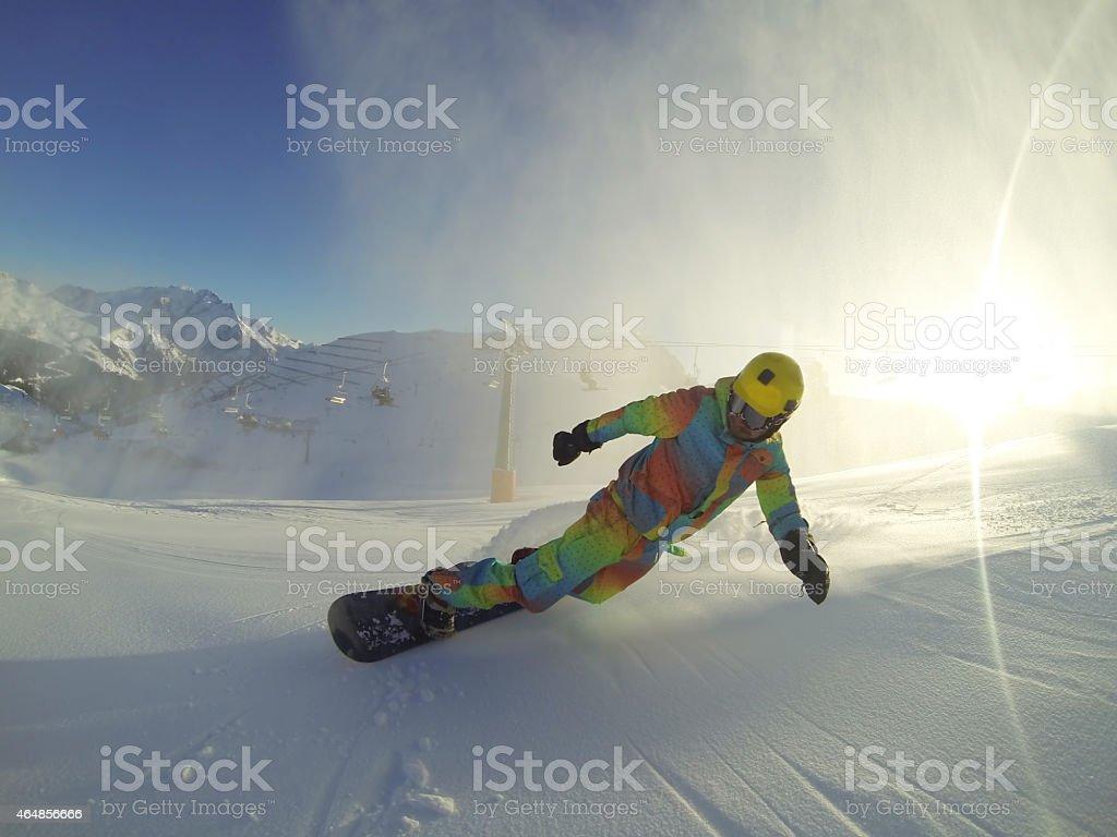 Snowboarder over the sun stock photo