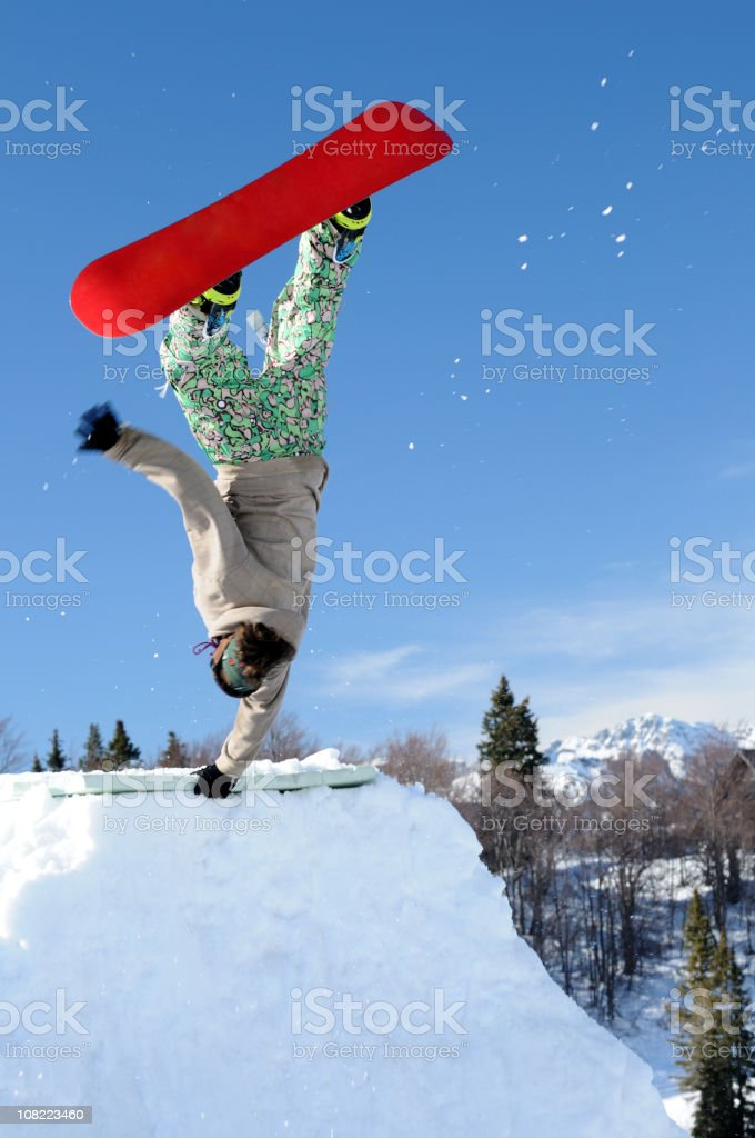 Snowboarder performing handstand royalty-free stock photo