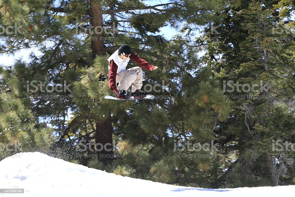 Snowboarder performing jump royalty-free stock photo