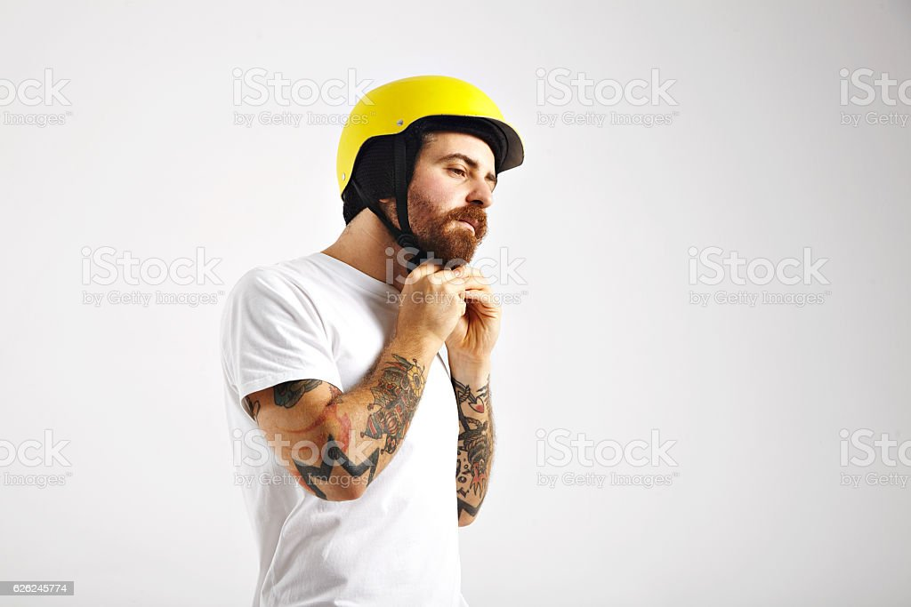 Snowboarder putting on and adjusting helmet stock photo