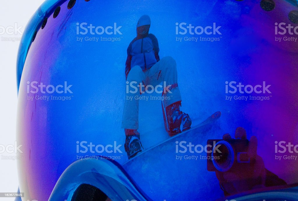 Snowboarder Reflected in Goggles stock photo