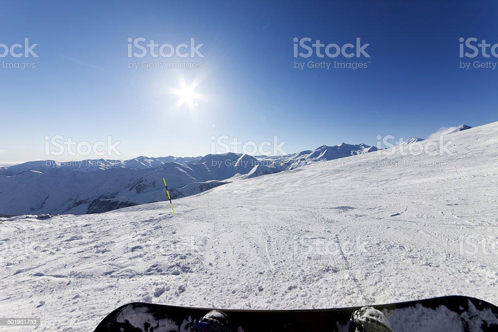 Snowboarder resting on ski slope royalty-free stock photo