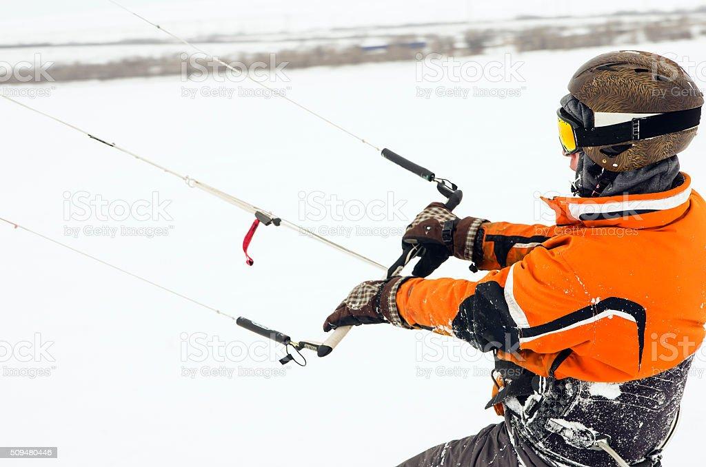 Snowboarder riding a kite stock photo