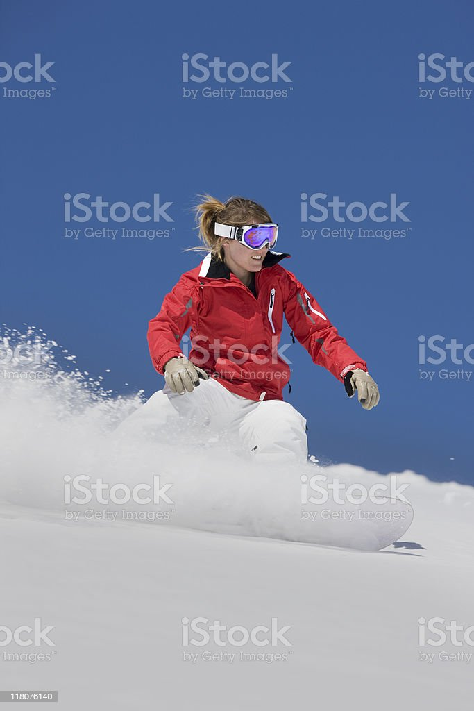 Snowboarder  Riding  Against Blue Sky royalty-free stock photo
