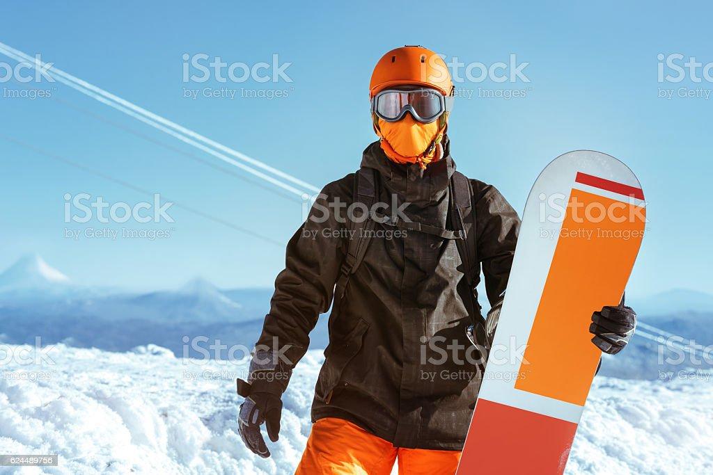 Snowboarder snowboard portrait mountain top stock photo