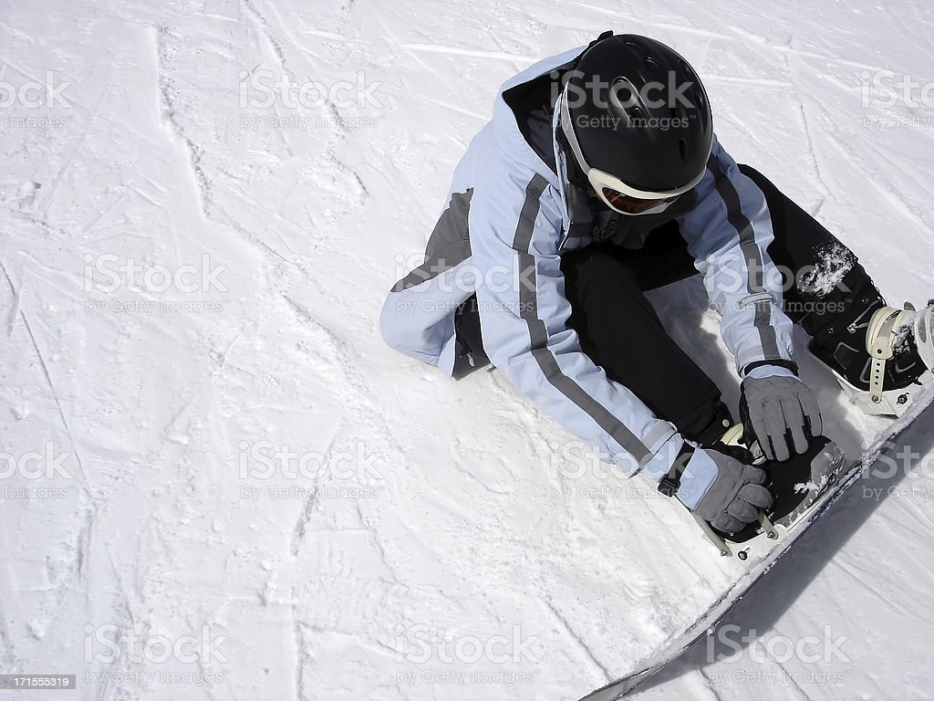 Snowboarder Strapping In stock photo