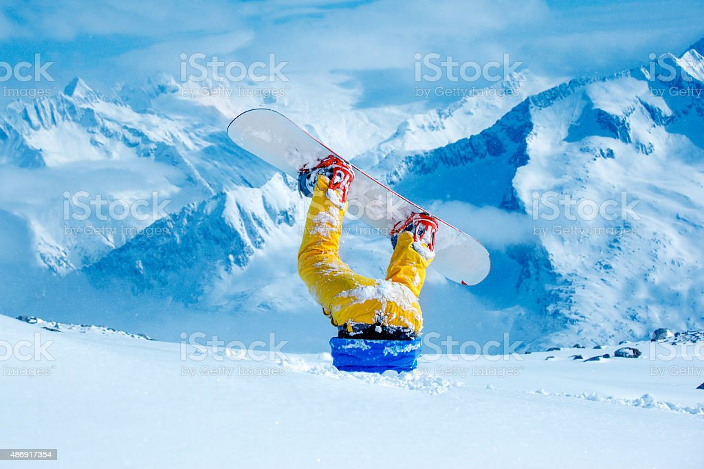 Snowboarder stuck in deep snow stock photo