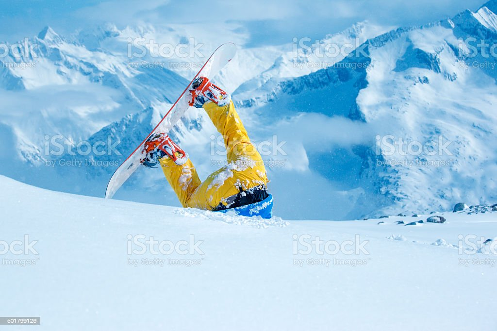 Snowboarder stuck in  snow stock photo