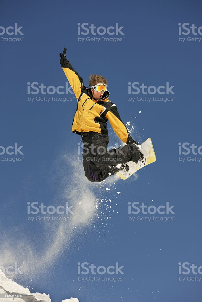 Snowboarder Taking A Jump stock photo