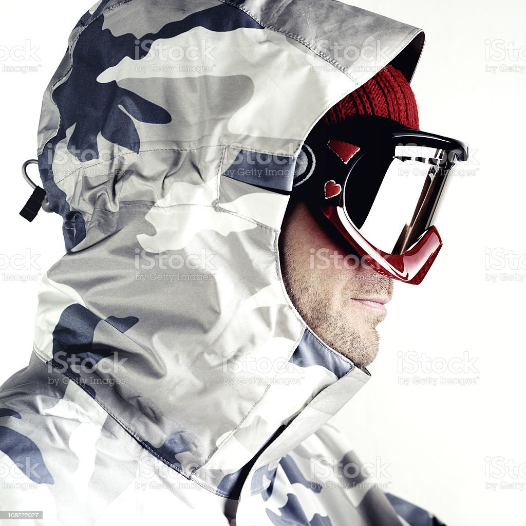 Snowboarder Wearing Camo Jacket and Goggles, Isolated on White royalty-free stock photo