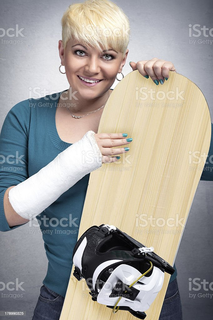snowboarder   with arm in cast royalty-free stock photo