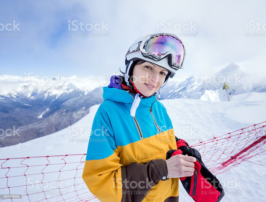 Snowboarder woman in mountains stock photo
