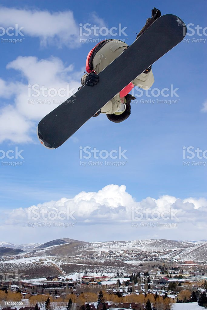 Snowboarder-blue sky over resort town stock photo
