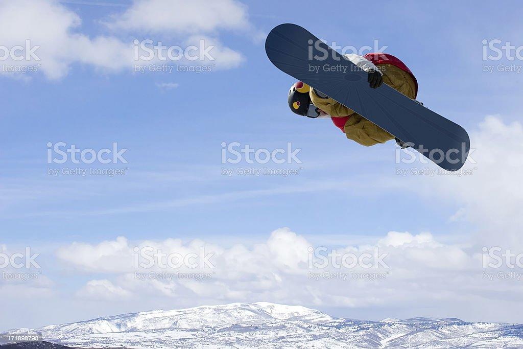 Snowboarder-Huge Air Heel Side Grab royalty-free stock photo