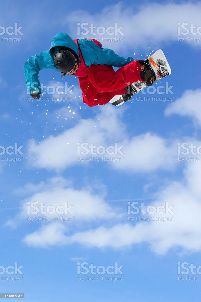 Snowboarder-red and blue outfit against beautiful sky royalty-free stock photo