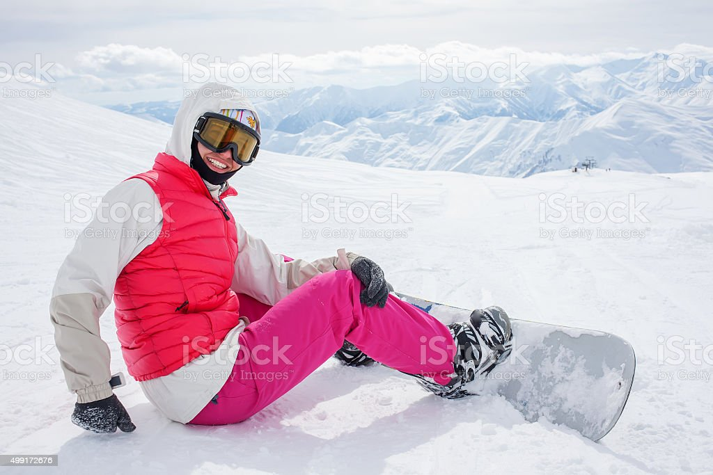 snowboarders is posing at camera stock photo