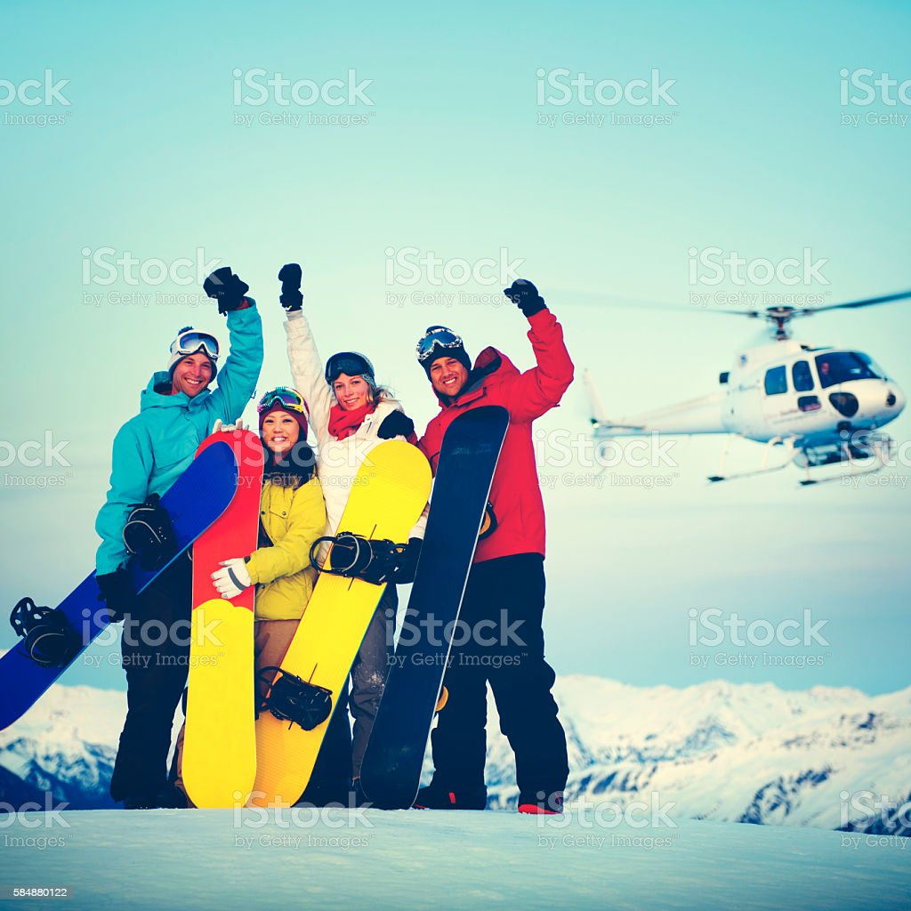 Snowboarders Mountain Ski Extreme Helicopter Concept stock photo