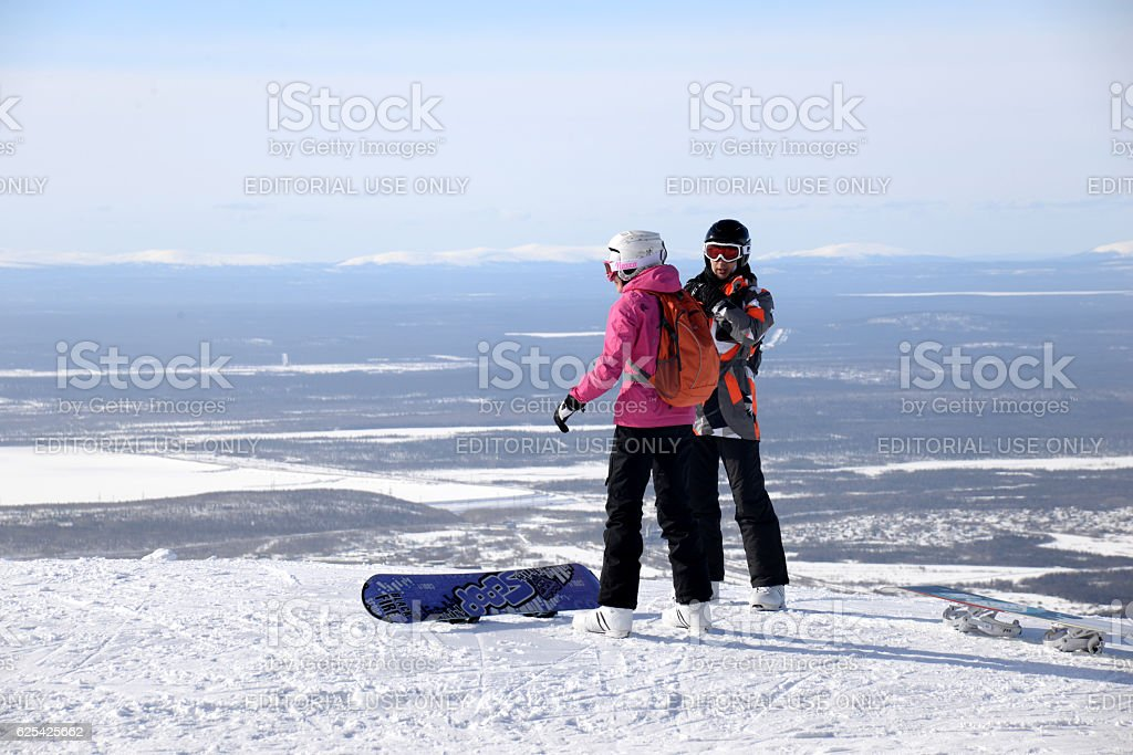 Snowboarders on the top of the  winter mountain stock photo