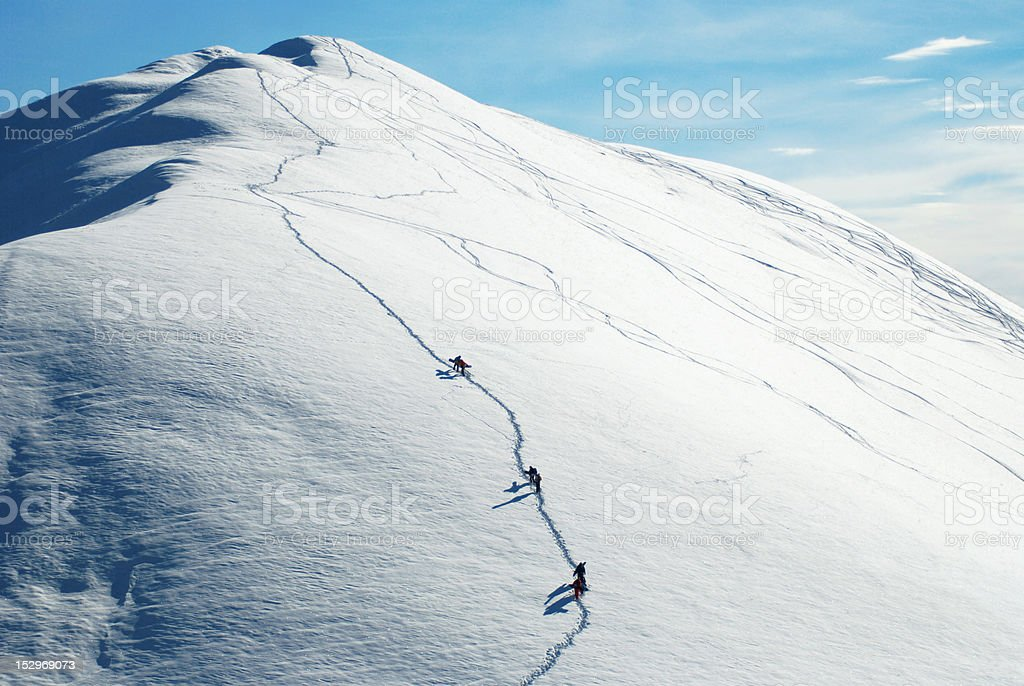 Snowboarders walking up the mountain royalty-free stock photo