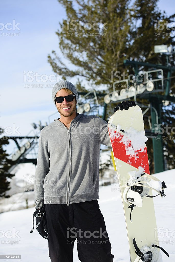Snowboarder--Smiling Male with Snowboard royalty-free stock photo