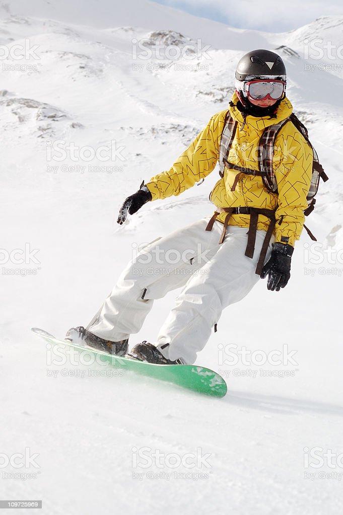 snowboarding at ski slope stock photo