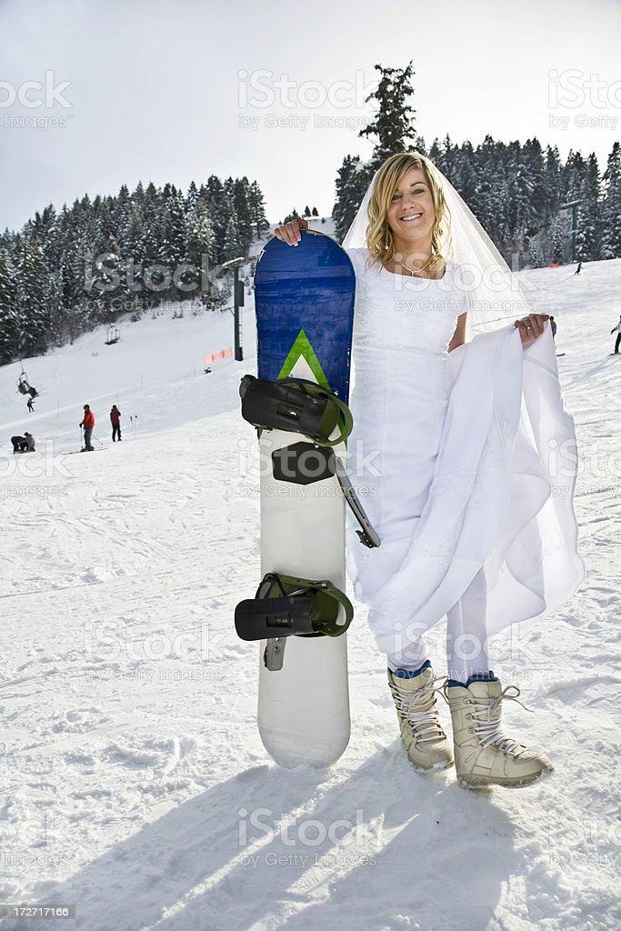 Snowboarding Bride. royalty-free stock photo
