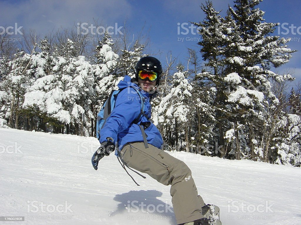 Snowboarding in action stock photo