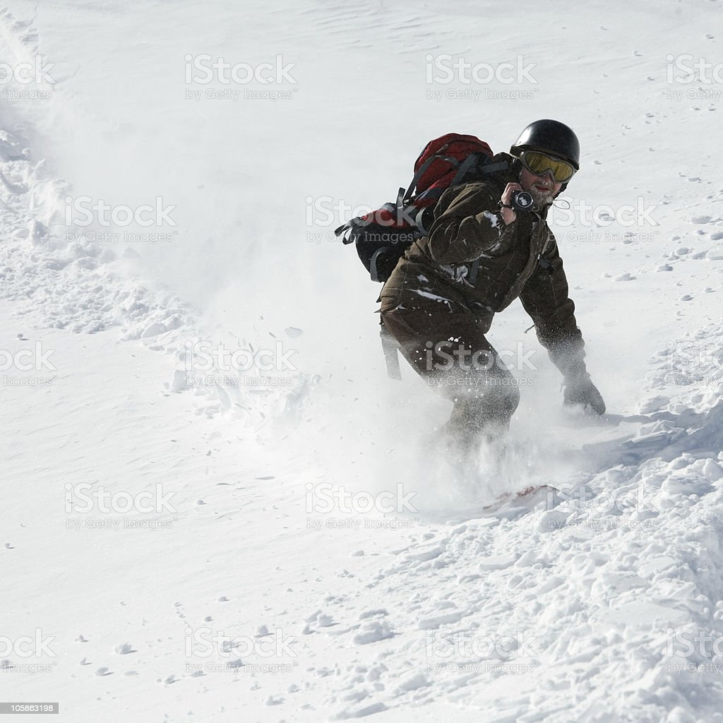 Snowboarding in powder snow royalty-free stock photo