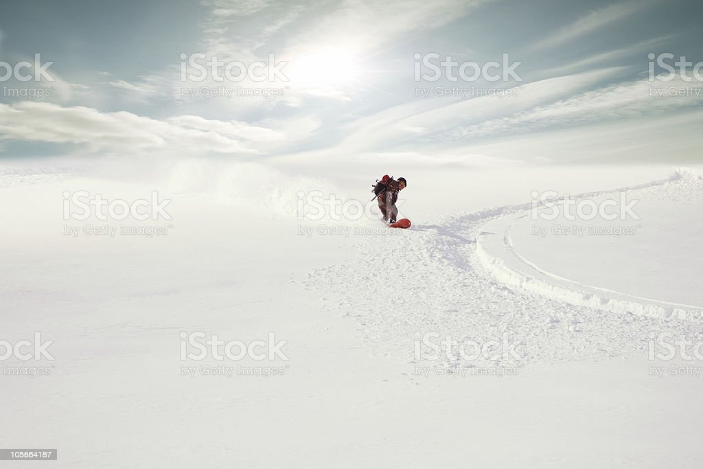Snowboarding in powder snow stock photo