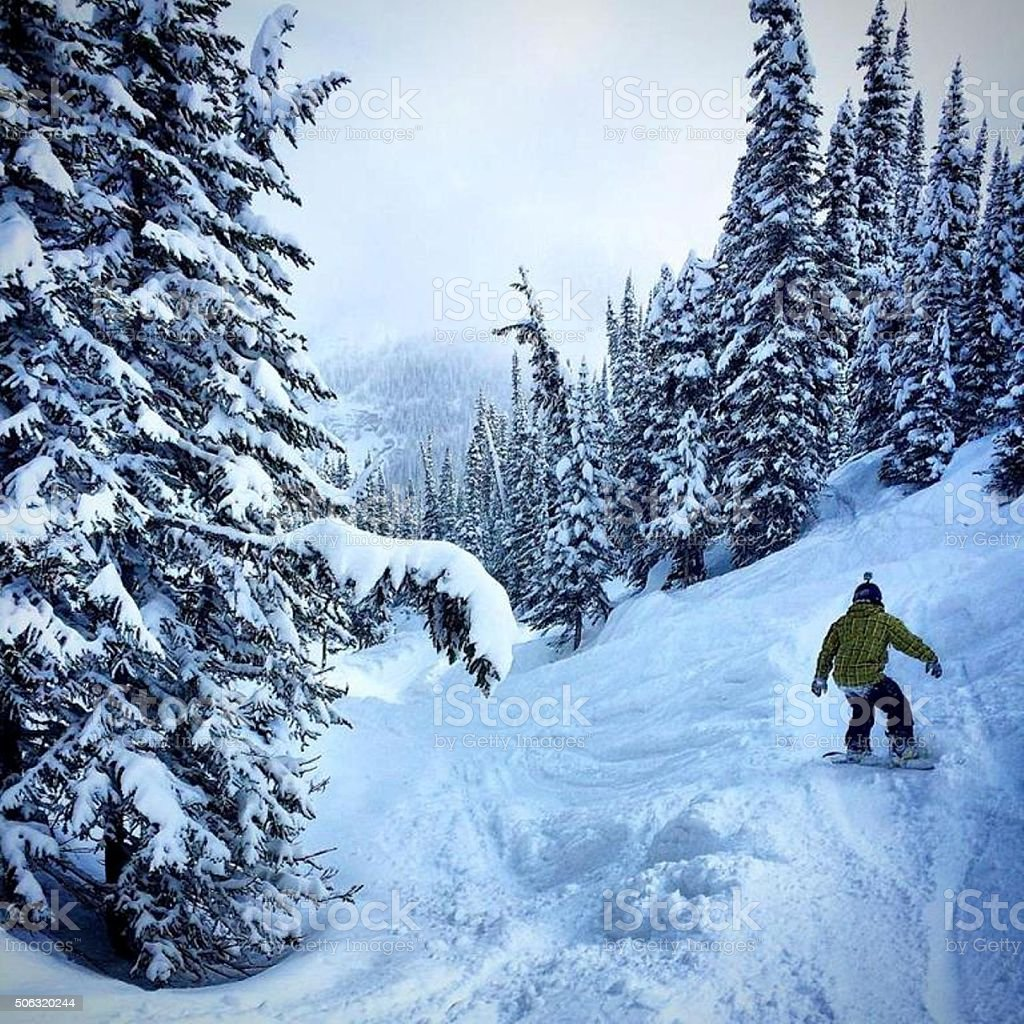 Snowboarding in the Rocky Mountains stock photo