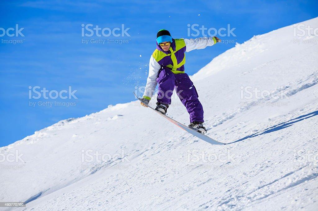 Snowboarding  jumping  Snowboarder freestyle stunt on the mountain ski slope stock photo